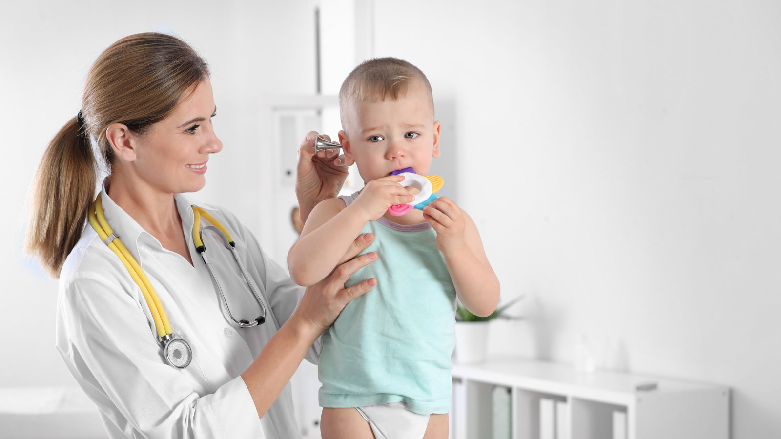 doctor seeing toddler
