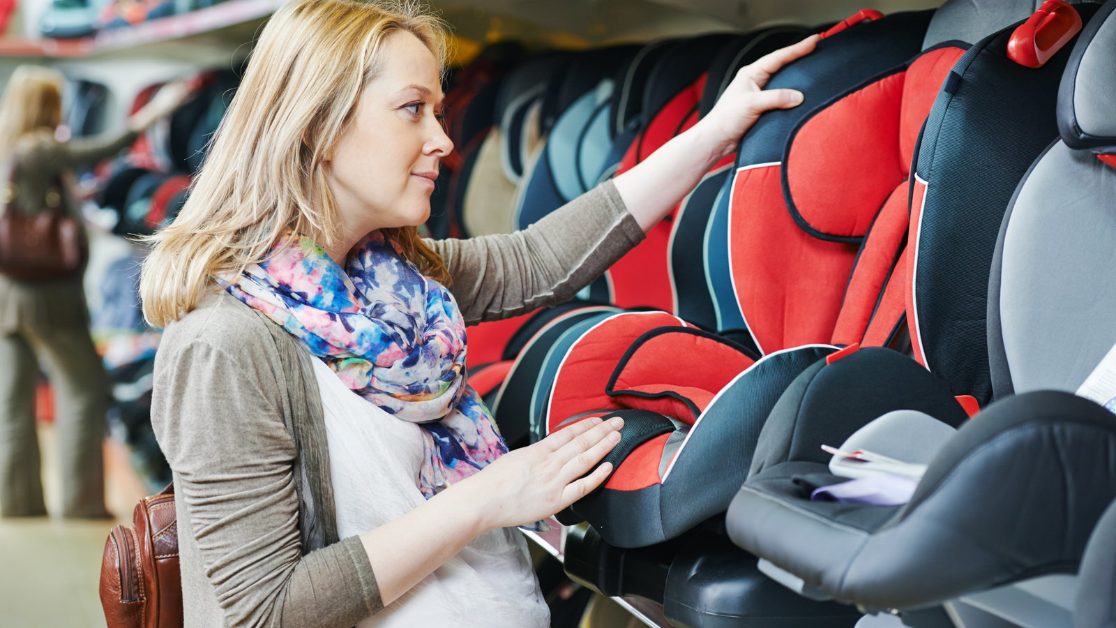 woman shopping for a car seat