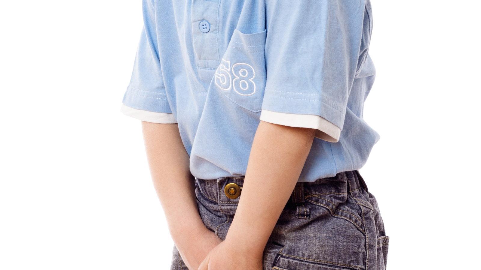 boy holding his bladder