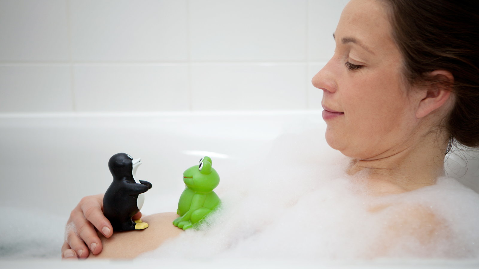 pregnant woman taking a bubble bath