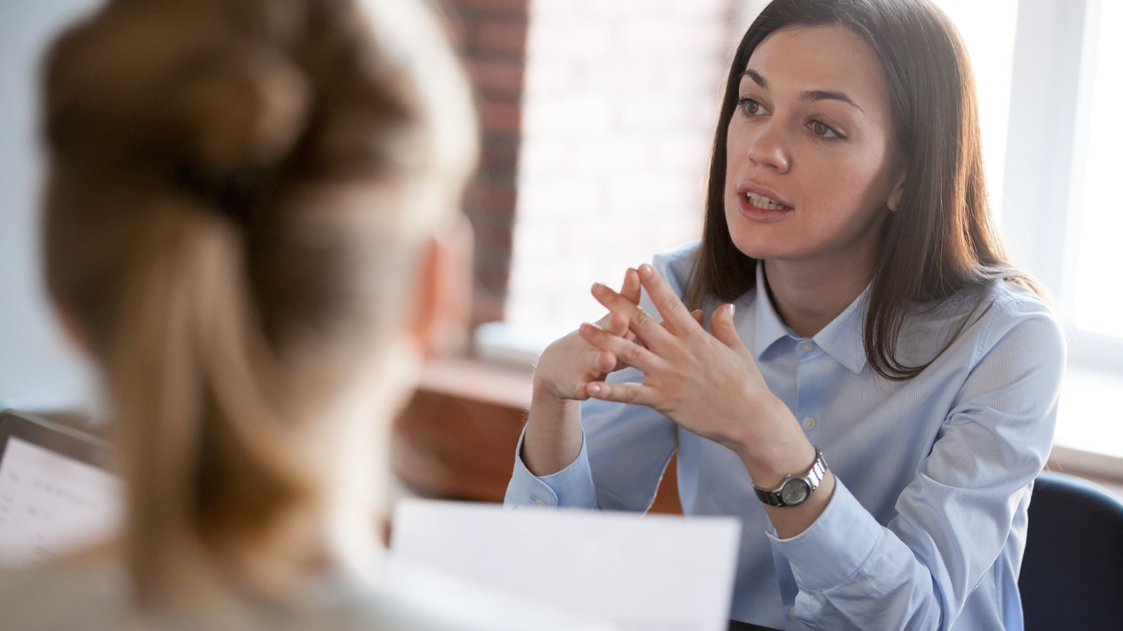 woman talking to employer