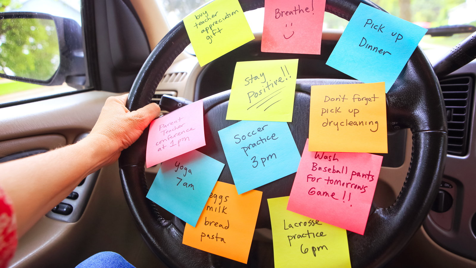 steering wheel covered with sticky notes