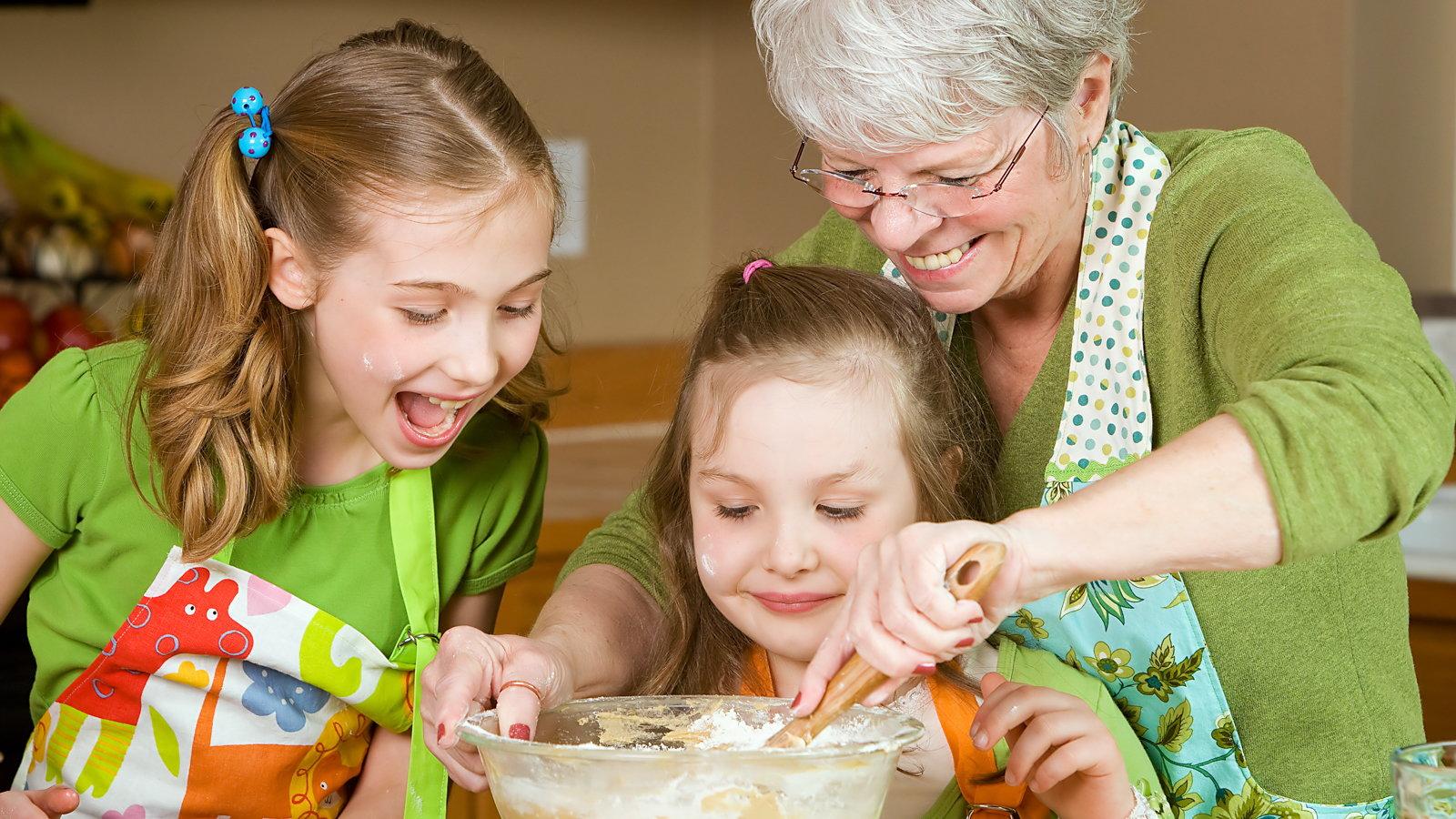 children helping grandmother bake