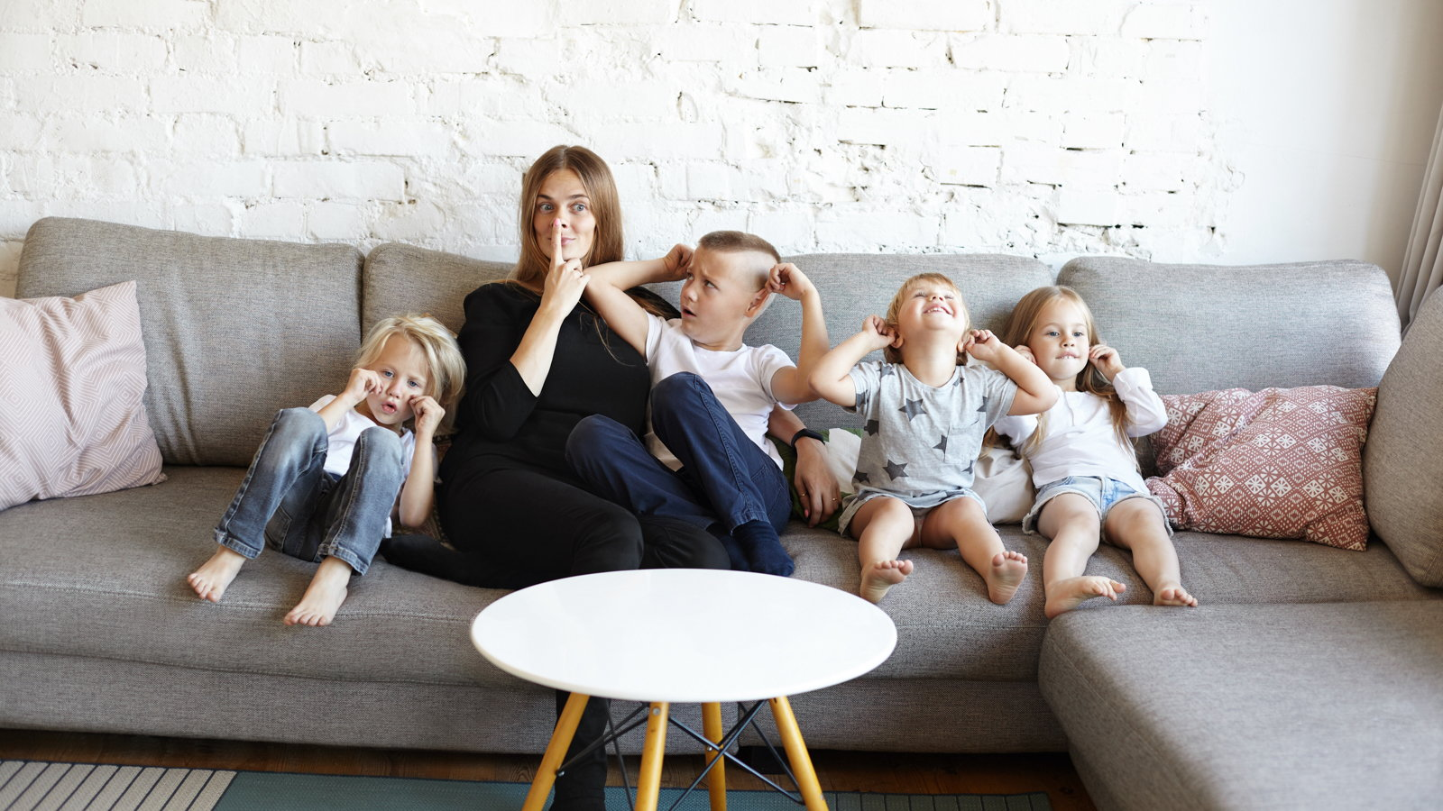 mom sitting with four kids on the couch