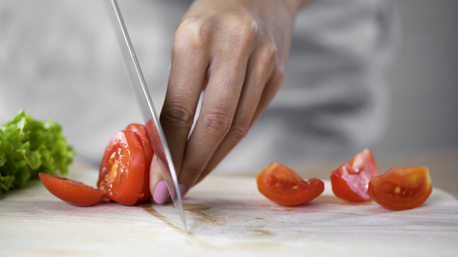 cutting up tomatoes
