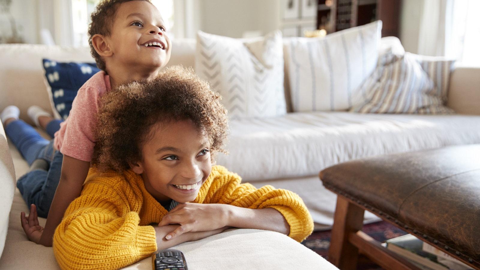 siblings watching television