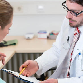 Woman reviewing medical information with a doctor pregnancy don