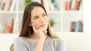 thoughtful woman when do pregnancy symptoms start