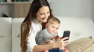 woman on tablet apps every new mom needs