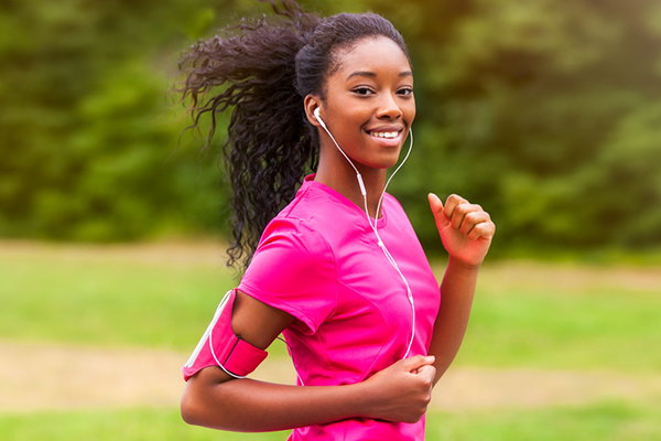 A young woman running.