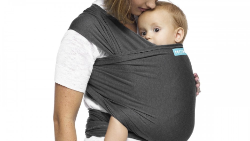 Mom wearing baby in a stretchy moby wrap.