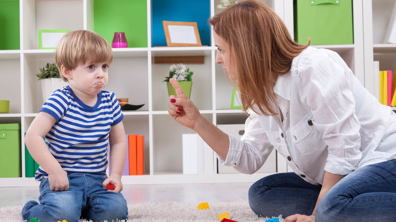 mother pointing one finger at toddler