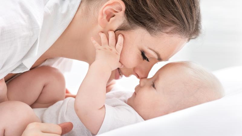 Woman cuddling baby