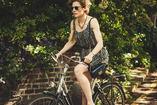 woman rides a bike to meditate