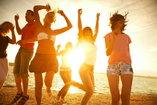 people dancing on a beach