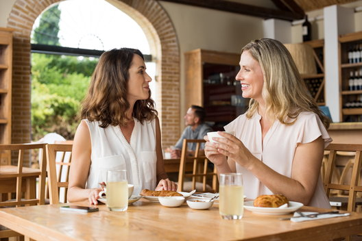 A recovering addict and her lay counselor discuss recovery over brunch.