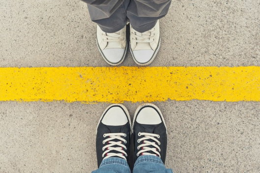 bird's eye view of a line between two people