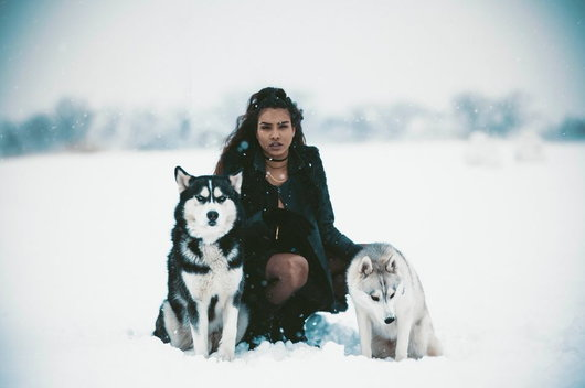 woman between 2 wolves
