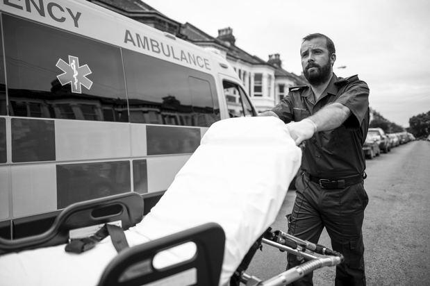 paramedic pushing a stretcher