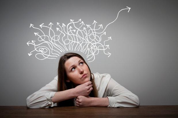 girl thinking imaginary arrows around her head