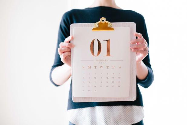 Person holding a calendar