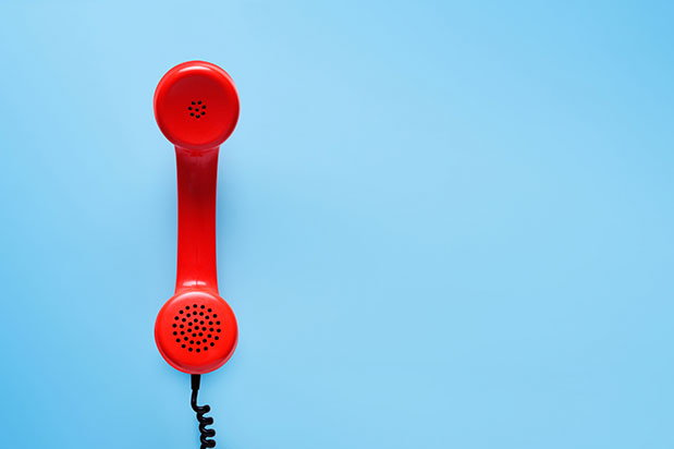 A red support and referral addiction recovery hotline phone.