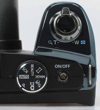 Olympus SP-820UZ_top-dial.jpg