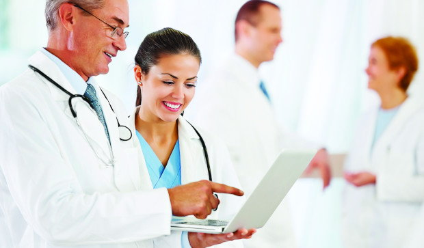 Doctor and nurse read collaborative report