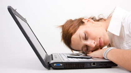 Woman sleeping on her laptop.