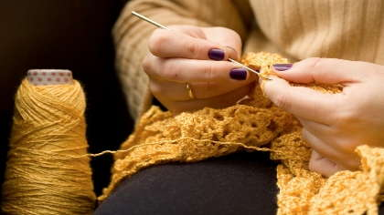 A woman crocheting.