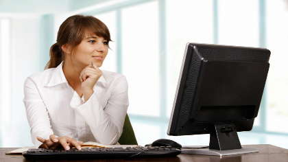 A young woman in front of a computer.