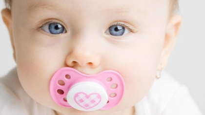 A baby with a pacifier.