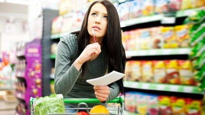 A mother looking over her grocery list.