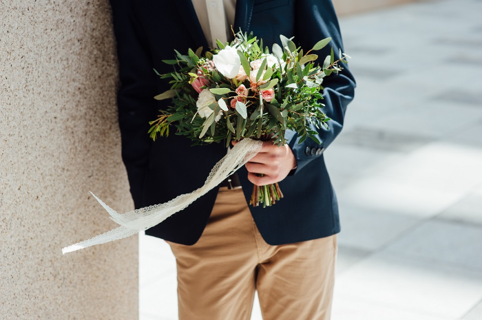 young man holding a bouquet