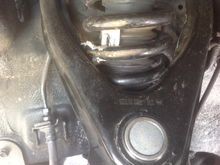 Stock control arm with inner flange ground down for clearance