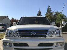 Original Toyota front grill, front mirror, front bumper lip and hid in headlights and fog lights