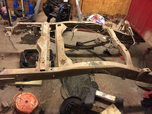 Got the bed off, most of the rear suspension ripped out, and fuel tank removed.