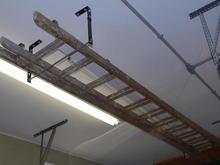 Homemade rack for storing ladder