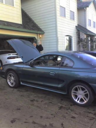 The second I drove it home, all Bone stock.  That's my dad there pretending like he even knows how to read a dip stick...