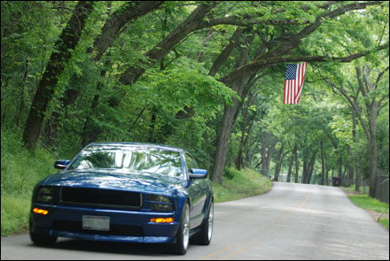 River Road Cruise w/ American Flag Backdrop