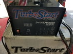 NEW TURBO START 16 V BATTERY AND SMART CHARGER
