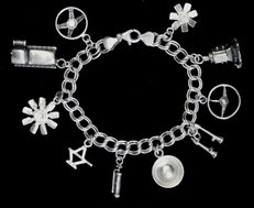 STERLING SILVER-AUTO PARTS CHARM BRACELETS (92.5)   for sale $180