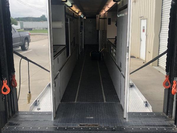 Featherlite lift gate trailer and semi