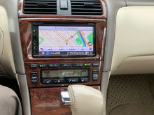 """Around June 2018 my 2004 Toyota XLS OEM Navigation partially failed. The remote which sits in a cradle or """"Controller Holder"""" between the front seats didn't seem to be working though if I held the remote above in front of the dashboard mounted Nav screen its IR sensor responded to the remote just fine controlling the OEM Nav, indicating the IR sensor in the cradle partially inop.  An electrical/electronic issue Toyota shops couldn't-wouldn't fix. So I went for  full aftermarket infotainment repl"""