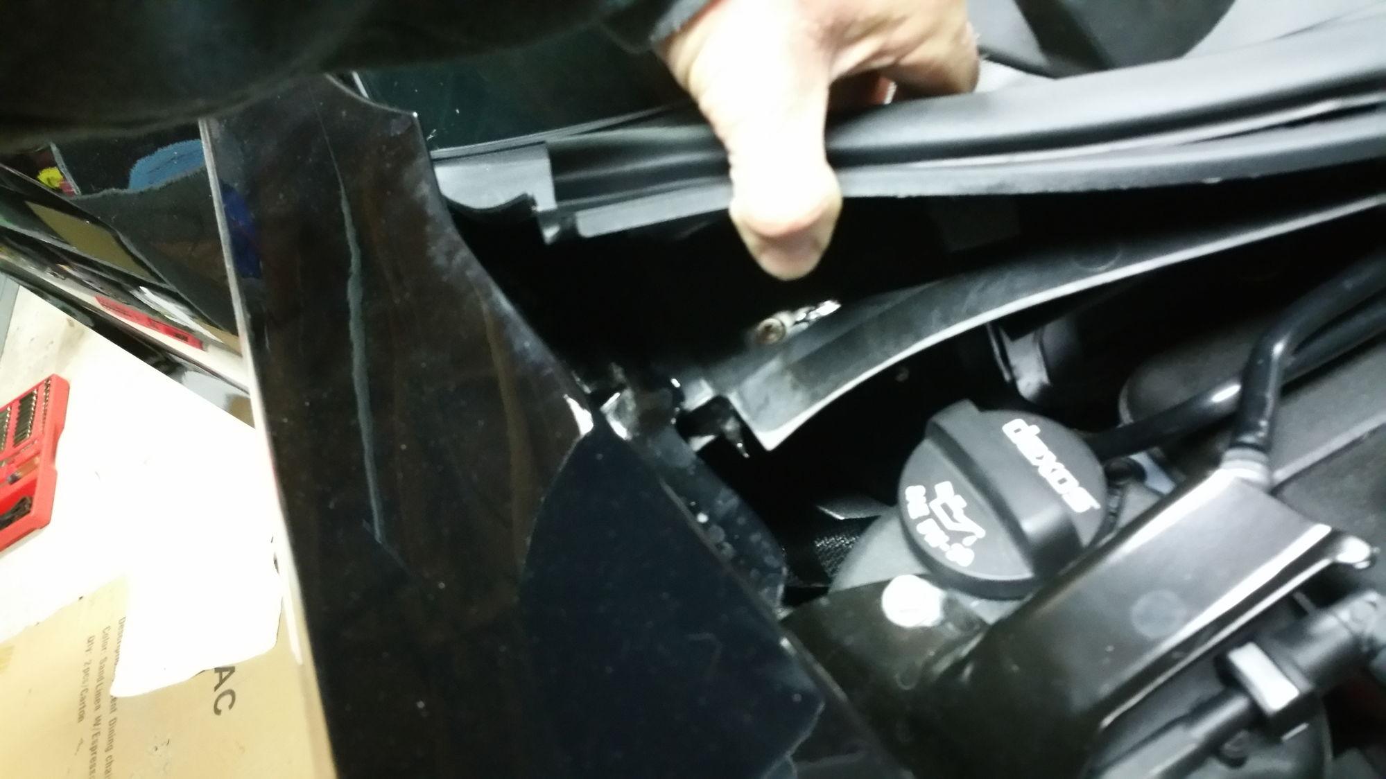 Remove bolt in door jam at top corner of fender