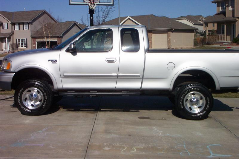 need picture of f150 with body lift and stock rims tires. Black Bedroom Furniture Sets. Home Design Ideas