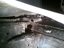 driverside inner fender well hole drilled for dash harness wire tuck