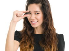 stock photo 20555792 young woman teeny tiny finger gesture