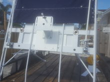 frontal view of t-top with sunbrella fabric, radar arch mounting unit, 2 VHF antennas and 2 outrigger donuts