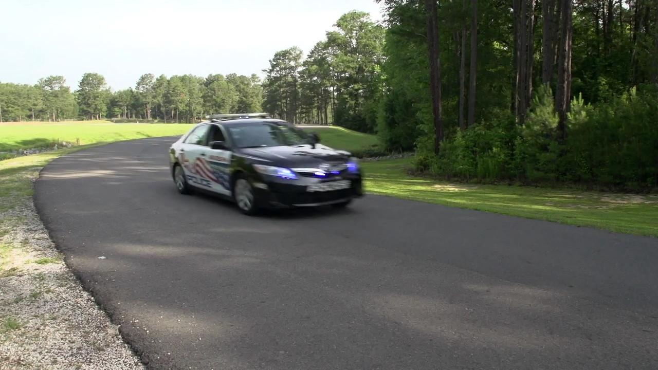 """Hybrid Law"" Toyota Camry Hybrid police car film screencap"